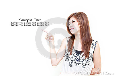 Young Asian woman pointing on white background