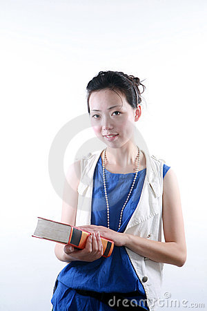 Young asian woman reading book
