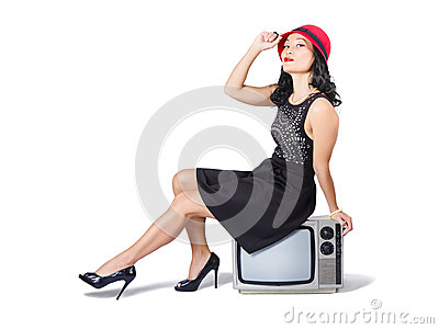 Young asian woman sitting on 70s tv set