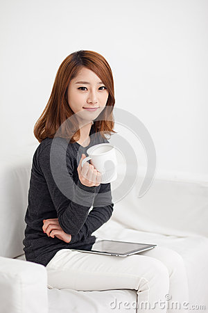 Young Asian woman using a pad PC