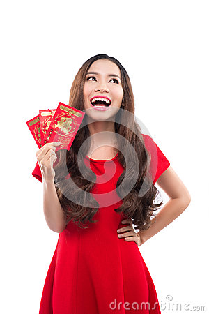 Free Young Asian Woman With Praying Gesture Wishing You Good Luck. Chinese Young Woman Showing The Lucky Money. Young Chinese Woman Hol Royalty Free Stock Images - 62999939