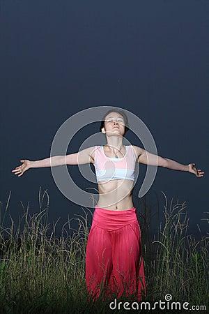 Young asian woman YOGA outside