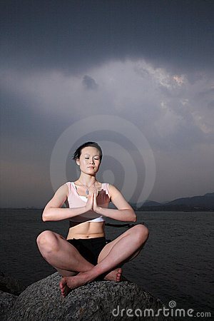 Young asian woman YOGA outside