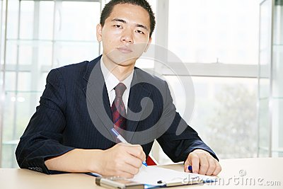 Young asian working in office
