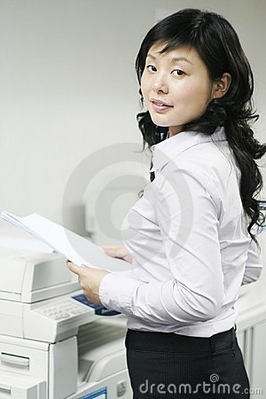 Young asian working with print