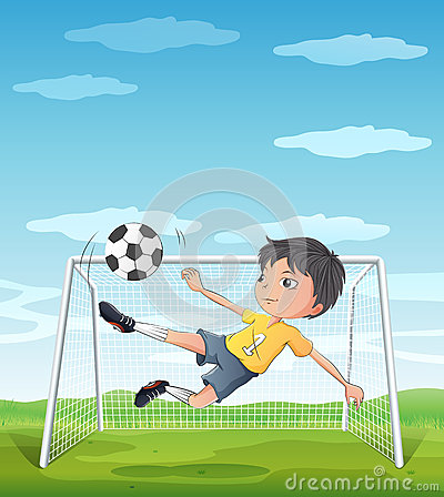 A young athlete kicking the soccer ball