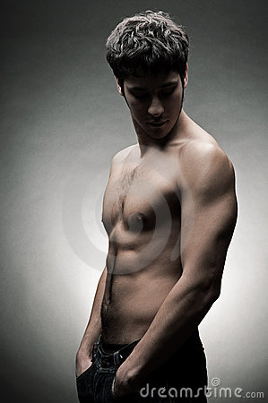 Young athlete with naked torso