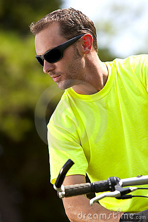 Young athletic man on bicycle