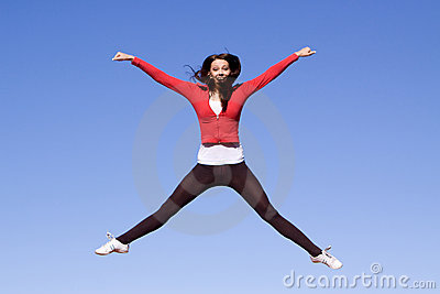 Young athletic woman jumping