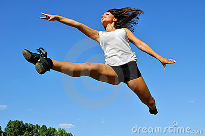 Young athletic woman in a long jump