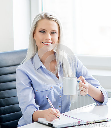 Free Young, Attractive And Confident Business Woman Working In Office Royalty Free Stock Photography - 57457987