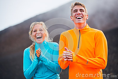 Young attractive athletic couple, wearing sporty cloths