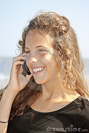 Young attractive beauty making a phonecall