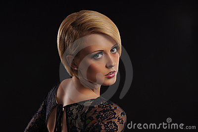 Young attractive blond over dark background