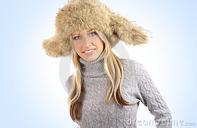 Young and attractive blond wearing a winter hat