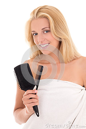 Young attractive blonde with hairbrushes on white background