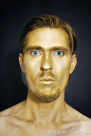 Young attractive blue-eyed men with gold makeup