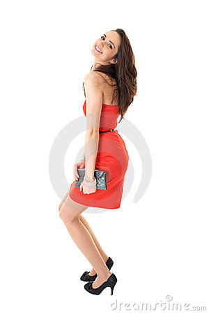 Young attractive brunette female in red dress