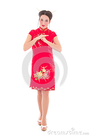 Young attractive brunette in red japanese dress isolated on whit