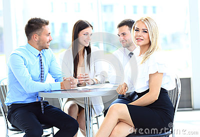 Young attractive business woman in a meeting
