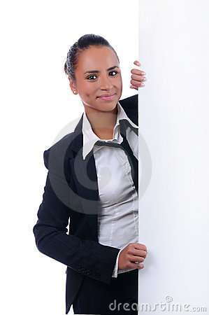 Young attractive businesswoman behind the wall