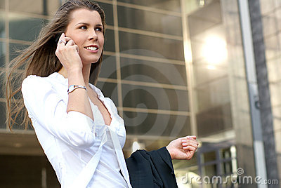 A young and attractive businesswoman with a phone