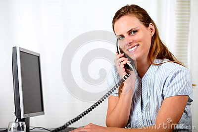 Young attractive businesswoman on phone