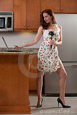 Young attractive caucasian woman in the kitchen