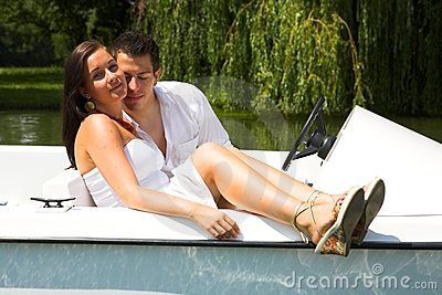 Young attractive couple on boat