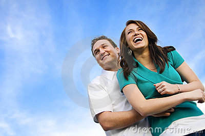 Young Attractive Couple Laughing Together