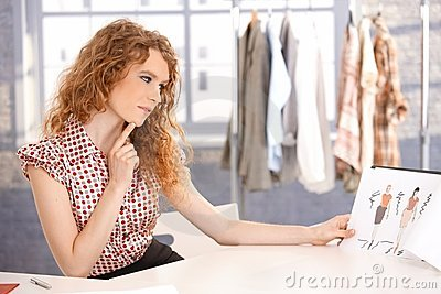 Young attractive fashion designer working