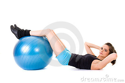 Young attractive female exercise using blue ball