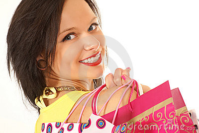 A young and attractive female with shopping bags