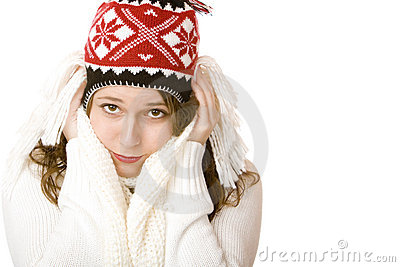 Young attractive freezing woman with cap and scarf
