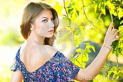 Young attractive girl with blue dress outdoor