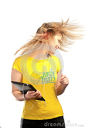 Young attractive girl dancing with a mp3 player