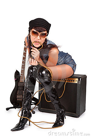 Young attractive girl on guitar amp