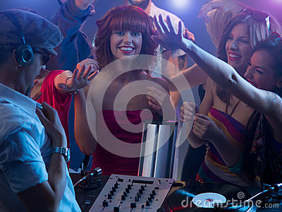 Young attractive girl laughing at party with dj
