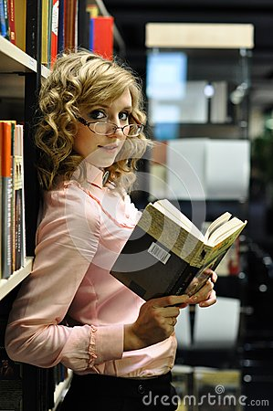Young attractive girl in a library
