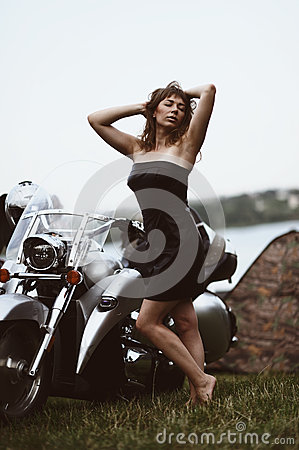 Young attractive girl and motorcycle