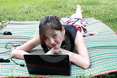Young attractive girl is relaxing in the park