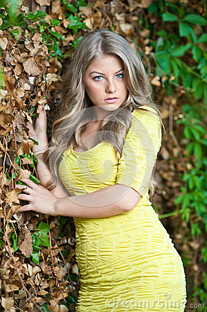 Young attractive girl with yellow dress outdoor