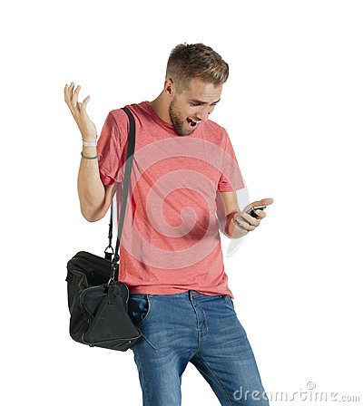 Young attractive guy acting surprised while using his mobile phone