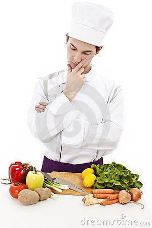 Young attractive man, chef thinking what to cook