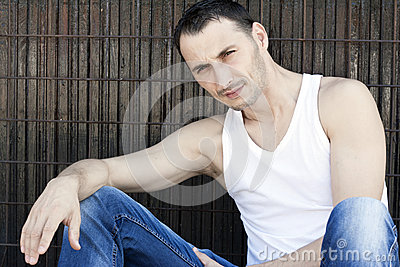 Young attractive man sitting