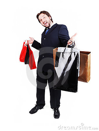 Young attractive man wearing suit and holding shop