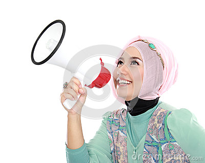 Young attractive muslim woman shouting using megaphone