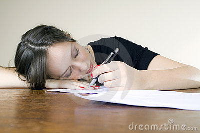 Young attractive secretary asleep at her desktop