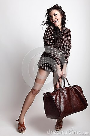 Young attractive sexy girl posing with bag