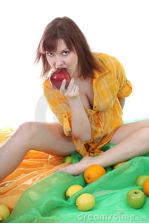 Young attractive woman biting red apple
